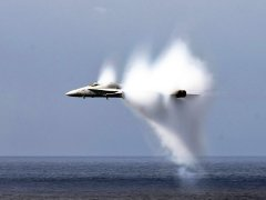 this-jet-torrentially-whips-up-air-and-sea-water-as-it-zooms-past