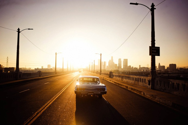 car-driving-into-sunset